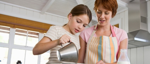 mother_teaching_daughter_to_cook